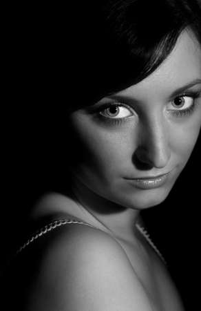 Black and White portrait of teenage girl with big eyes
