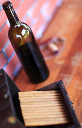 angled view: High angled view of bottle of wine and open box box of cigars