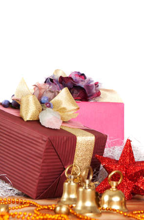 Close-up view of Christmas presents and ornaments over white background with copyspace