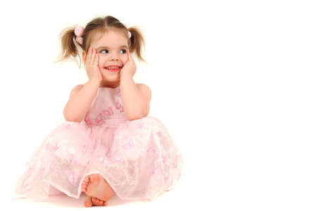 Portrait of young girl in pink princess dress, studio shot Stock Photo