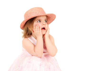 Portrait of young girl in pink princess dress and hat with shocked expression, studio shot