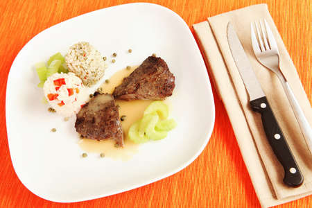 Still life view og gourmet beef steak with rice and celery on laid table surface