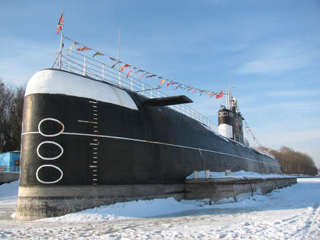 Submarine in dock. Frozen in ice Stock Photo