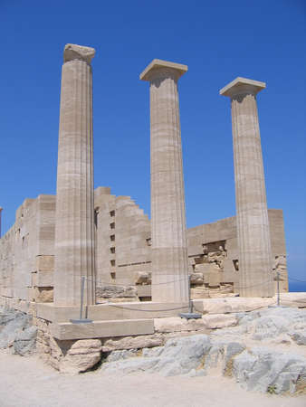 ancient columns of Greek temple in summer day photo