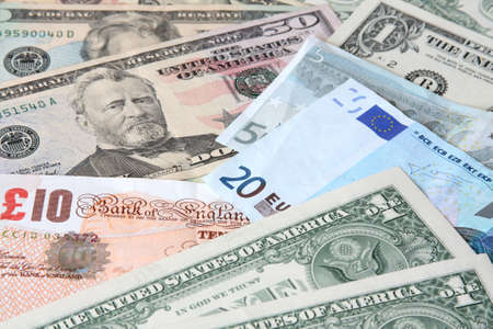Money. World currencies: U.S. dollars, pounds and euros. Banknotes.