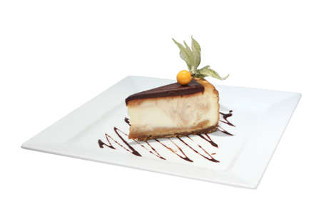 Cheesecake with chocolate decorated physalis. Isolated on white 免版税图像