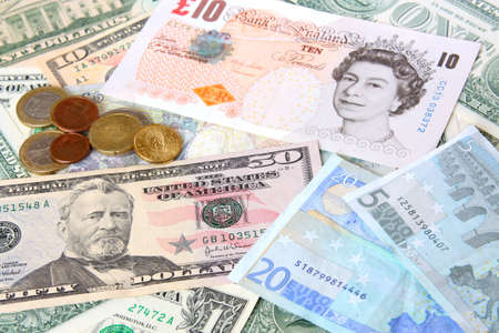 Money. World currencies: U.S. dollars, pounds and euros. Banknotes and coins