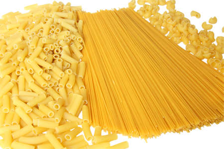 A lot of pasta. Background made from spaghetti and penne. Isolated on white photo