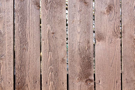Wood Background. Fragment of an old fence of wood with knots Stock Photo - 4883157
