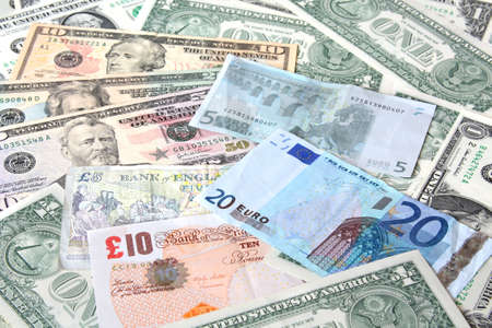 Money. World currencies: U.S. dollars, pounds and euros. Banknotes