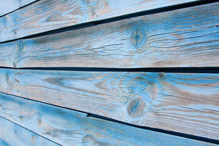 Wood Background. Fragment of an old wall of wood with knots photo