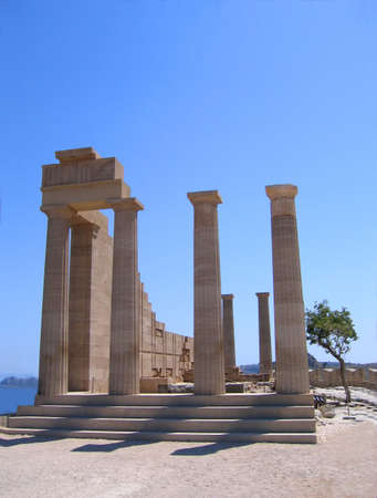 Ruins of ancient Greek temple with columns in summer day. Lindos, Rhodes photo