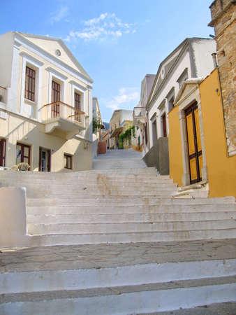 Steps of alleyway leading upwards Symi Greece Stock Photo - 5193569