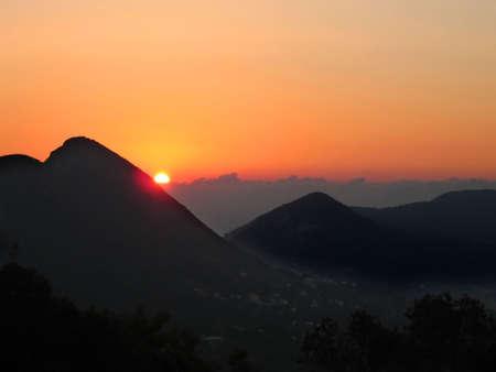 Orange sunset in the mountains. Corfu island, Greece Stock Photo