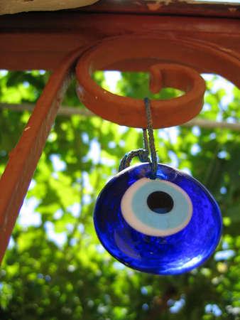 talisman: Evil eye - talisman of blue glass. Mediterranean people believed that evil eye keeps evil things away and brings good luck