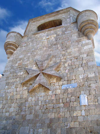 Tower with turrets in the residences of St. John knights on Mount Filerimos, Rhodes, Greece photo