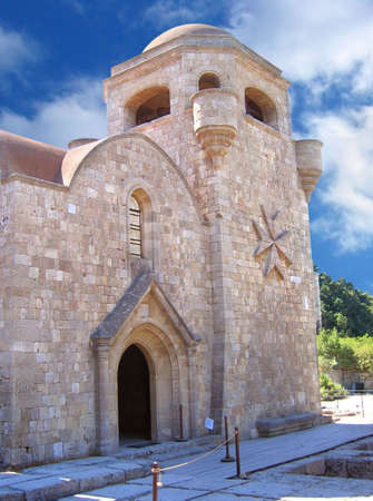 crusaders: Tower with entrance to the residences of St. John knights on Mount Filerimos, Rhodes, Greece                          Stock Photo