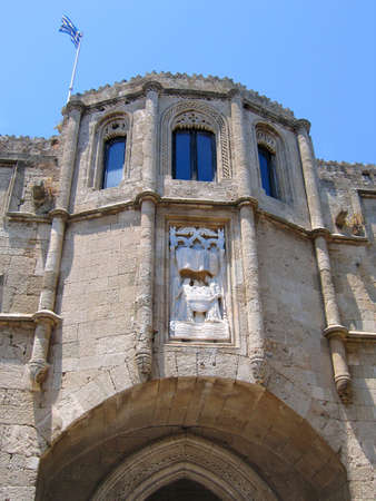 Detail of a medieval building in Rhodes, Greece. Bay window with bas-relief photo