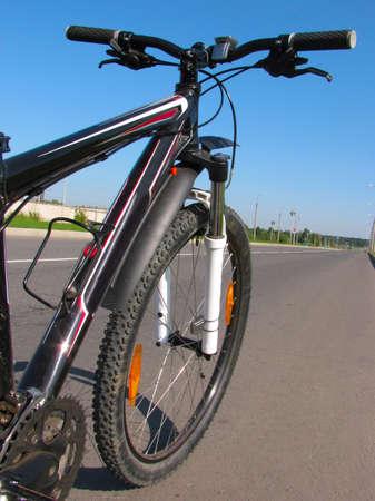 Mountain bike on asphalt road, running to the horizon Stock Photo - 5503240