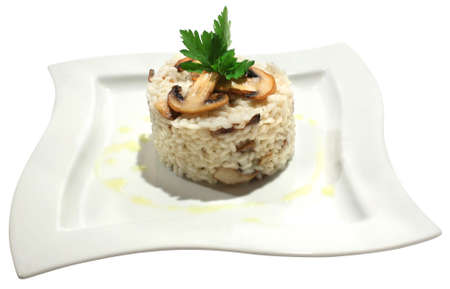 Italian cuisine - risotto with mushrooms and parsley. Isolated on white