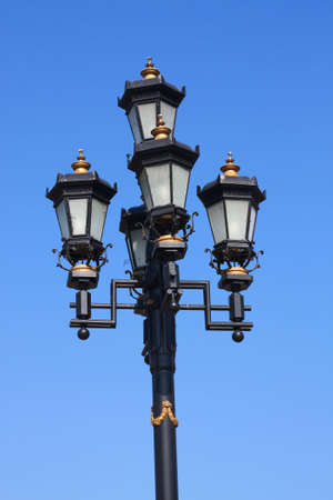 Close-up of old style street lamp  photo
