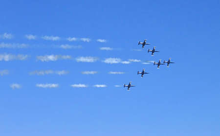 Fighter squadron formation leaving smoke trails