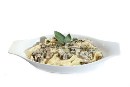 Italian cuisine - pasta with mushrooms, herbs, cream sauce and sage. Isolated on white
