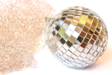 Disco ball and gold tinsel. Isolated on white photo