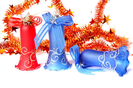 Blue and red Christmas Bells and tinsel. Isolated on white Stock Photo - 6049405