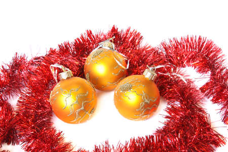 Golden Christmas balls and red tinsel. Isolated on white photo