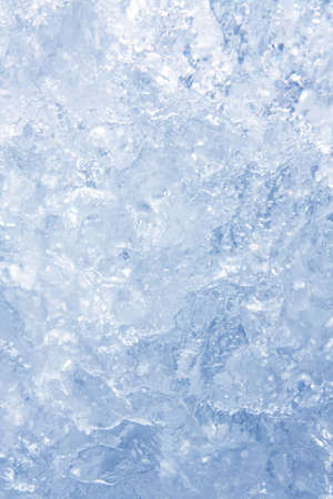 Full frame ice background, frozen water, blue