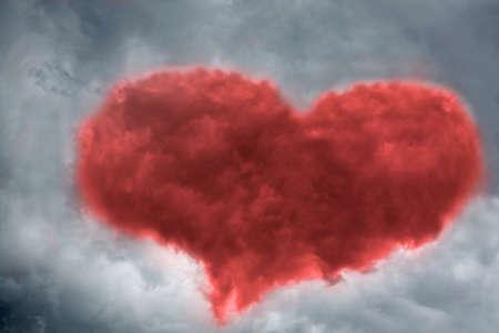 Heart shaped cloud on stormy sky