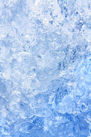 Full frame ice background, frozen water, blue