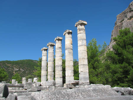 Columns of ancient Greek temple in summer day photo