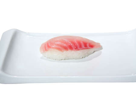 Nigiri sushi with seabass on a plate. Isolated on white Stock Photo