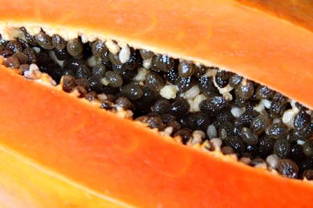 bisected: Close-up of bisected orange papaya