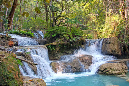 Waterfall Kuang Si in the jungle near Luang Prabang, Laos photo