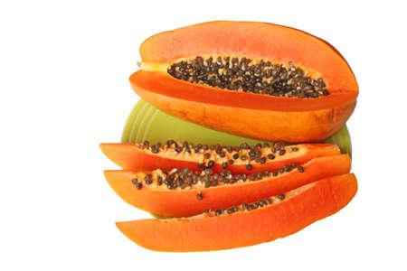 Ripe orange papaya on a plate. Isolated on white