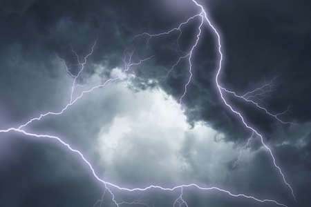 The lighting in dark stormy clouds Stock Photo - 7349891