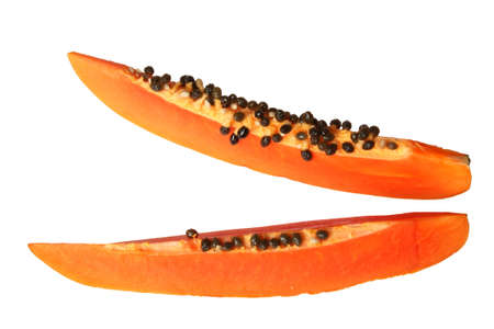 bisected: Close-up of two papaya slices. Isolated on white