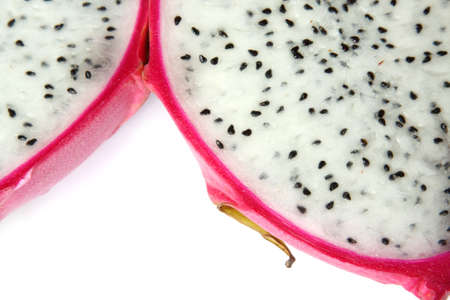 Close-up of bisected dragon fruit. Isolated on white Stock Photo