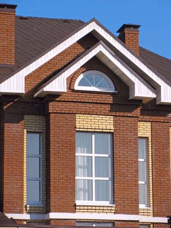 blue facades sky: Facade of suburban brick house Stock Photo