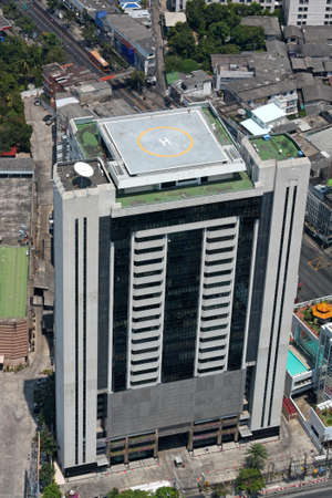 Office building with a helipad on the roof. Top view