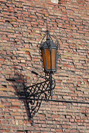 Close-up of old style street lamp on a brick castle wall Stock Photo - 7913088