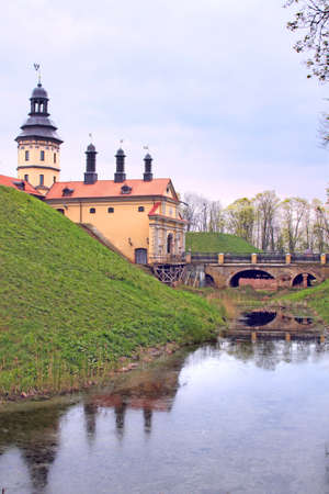 Niasvizh Castle in Belarus and its reflection in a moat Stock Photo - 8581937