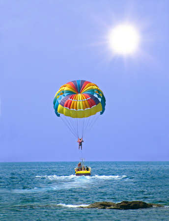 parasailing: Rainbow Parasail launch from boat in Turkey