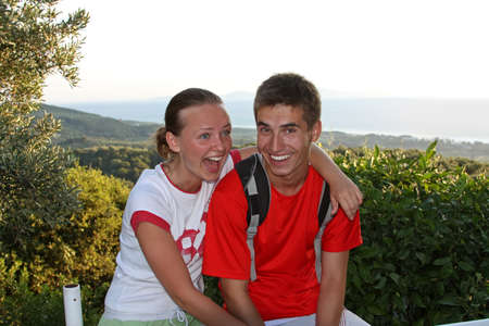 Outdoor portrait of a happy teenage couple  photo