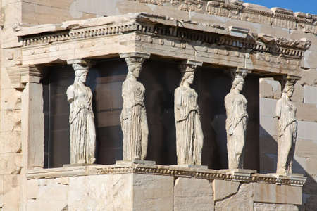 The ancient Porch of Caryatides in Acropolis, Athens, Greece  photo