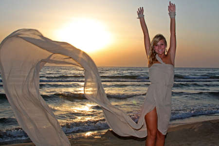 Happy young woman at the beach. Enjoying life photo