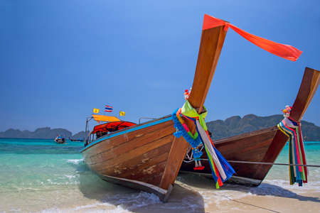 longtail: Longtail boats landing in Phi-Phi Island, Thailand